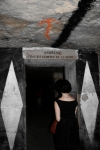 "Libby descends into the catacombs.  Oh, and that sign says ""Stop! Here lies the empire of death"".  Yikes."